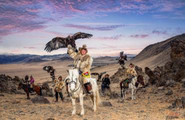 Kazakh Eagle Hunter riding horse in Olgei,Western Mongolia._592143788