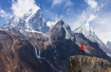 Woman-looking-at-the-mountains,-Mount-Everest-National-Park-185099409_5616x3744