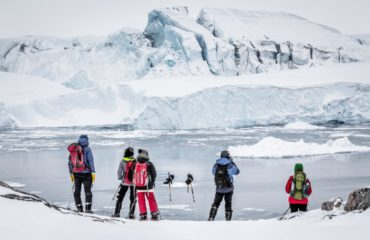 A group of snowshoers stop to photograph the icebergs in Ilulissat Icefjord - Samuel Letecheur - Visit Greenland