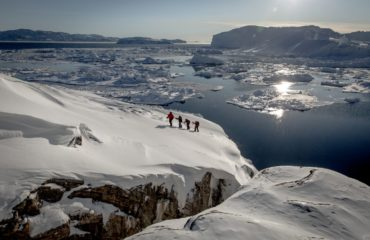 Snowshoeing near Sermermiut on the edge of the Ilulissat ice fjord in Greenland - Photo by Mads Pihl Visit Greenland